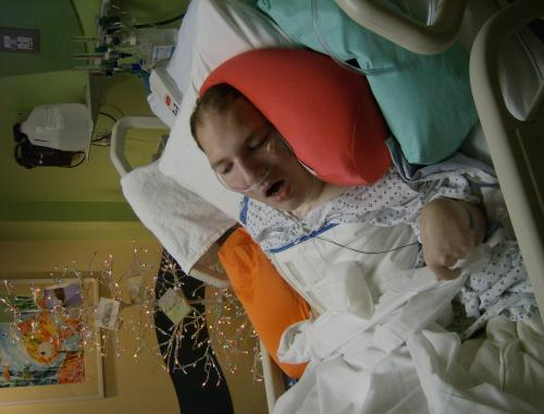 Brad in the hospital on January 3, 2009.  His Christmas tree is in the background.