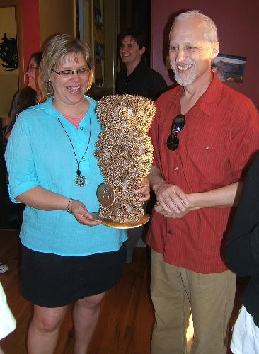 Dan and Melissa were awarded a special trophy for 25 years of marriage.