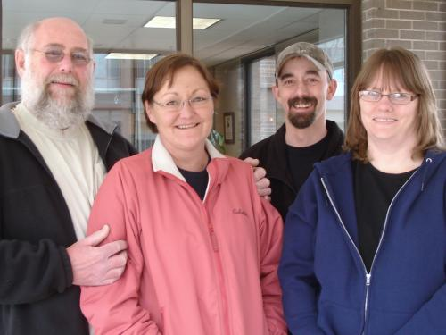 Ross, Julie, Keith, and Poppe outside Craig Hospital during their recent visit.