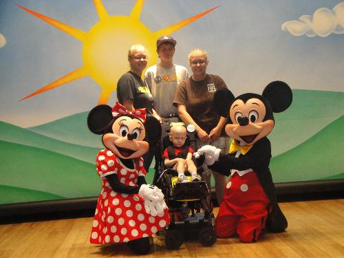 Aidyn's make a wish trip with Mickey and Minnie Mouse.