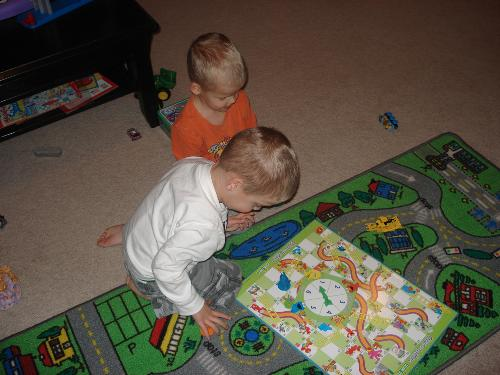 Isaac (top) and Evan (bottom) playing Chutes and Ladders