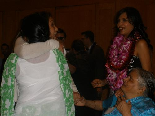 Rose-Anne hugs the family and holds Aji's hand (Mina's mom), at the A3M benefit