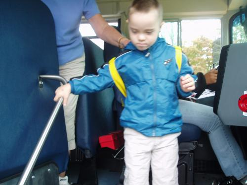 Landon getting off the school bus for the first time!!!!