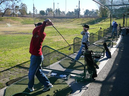 Christian hitting some golf balls with Garrett. 1/07  Nice swing CB :)