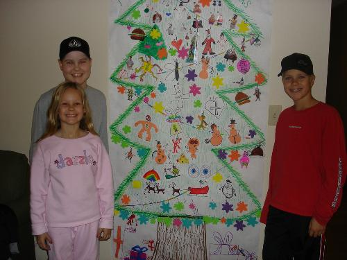 The Barker kids by our 'Christmas tree' at the Ronald McDonald house 12/06.