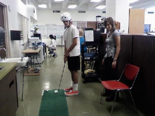 Putting during rehab!...and rocking the orange vans!