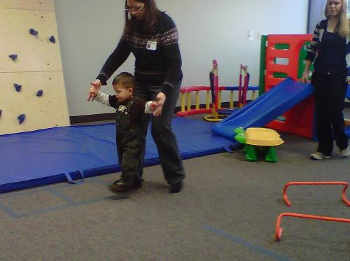 Walking in Physical Therapy with the help of his AFO's and his new shoes! :D
