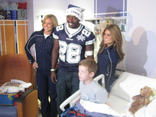 Dallas Cowboy Felix Jones (I think, I'll have to check with Lance) and a couple of Dallas Cowboy Cheerleaders.