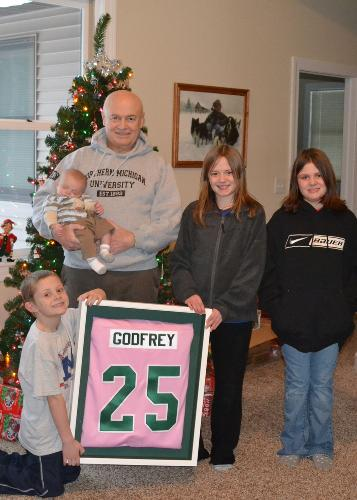 Ken with his grandchildren on December 23, 2010.  Great Jersey from his coworkers at NMU!
