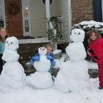 "Their first ""real"" snowmen (usually they are about 12 inches tall and last about 30 minutes :) )"