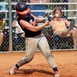 Big sister Lacey at her last tournament getting a great hit! He likes this picture bc it makes her feel strong