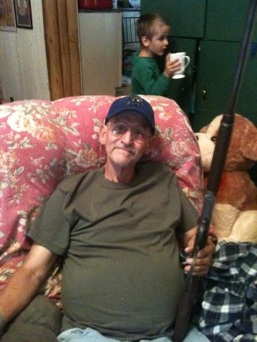 With his rifle Bonnie bought him last year.  He loves it, and is so proud of it.