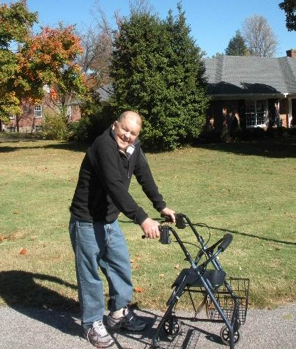 Here is the patient with his snazzy walker in front of our house. Oct. 28, 2010. This guy is quite weak.