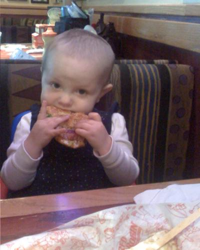 Hungry girl. She stole Daddy's hamburger and ate almost all of it!