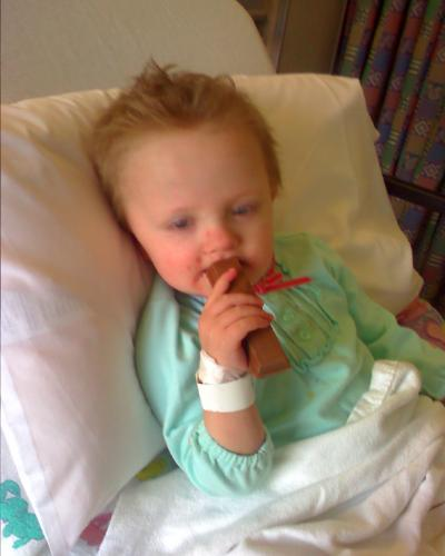 Rosemarie eating a BIG kit kat bar minutes after waking up from sedation.