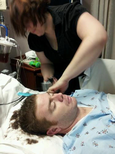 Josh getting a haircut from Beth!