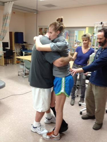 Kylie hugging dad at therapy!