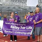 "Relay for Life. Wonderful moment when they announced that Chase Heaton was in remission! Thanks team ""Pretty in Purple""!!!!!"