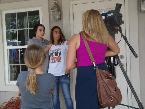 Zach and Mommy (Evette) giving a news interview at the first fundraiser for Evan after his diagnosis, May 2012