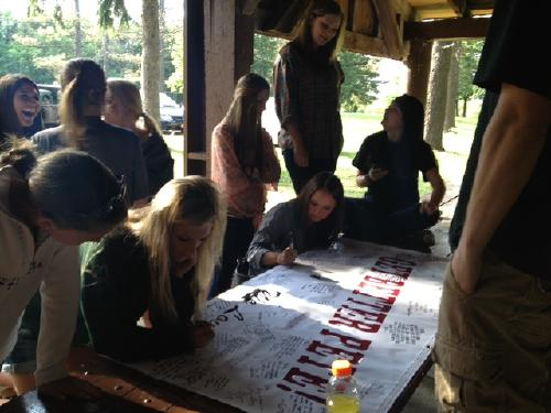 Signing the banner at Chestnut Ridge.