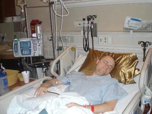 Me catchin some z's after a surgery.  Yes, that is a gold silk pillowcase.  Be jealous.