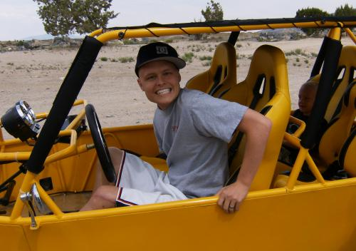 Driving the dune buggy.