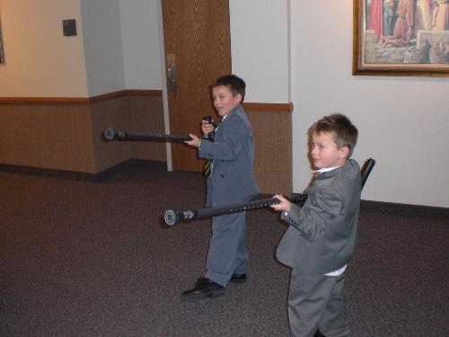My two nephews using my crutches as guns.  The sad thing is that they learned it from me.