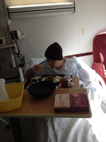 Enjoying hospital lunch.  It was his first real meal since September 18.