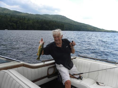 Dad fishing with his nephew Jimmy on Lake George.  1st catch of the day! He has always had great luck!