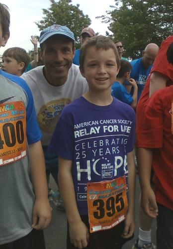 Getting ready to run his last mile of 26.2 for the Kids Country Music Marathon, 4-23-10...age 8