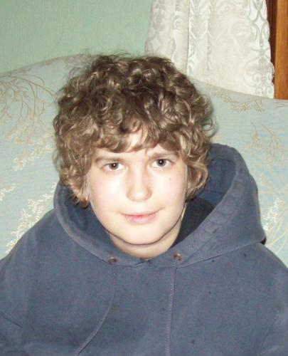 February 2009, with full head of curly hair.