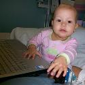 Hannah enjoying the computer while receiving her chemo.