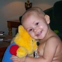 Hannah loving Grandma's Pooh Bear!