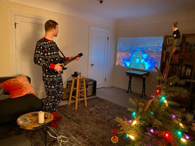 Victoria got me Guitar Hero Live for Christmas. RBG looks on from atop our Charlie Brown tree.