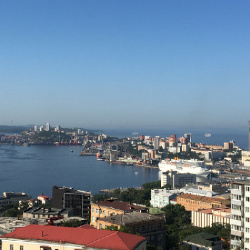 "The Artyukins' beautiful Far East port city, Vladivostok, September, 2018, during the festival of the Tall Ships Regatta -- you can see some of the ships under full sail just beyond the buildings in the background. Vladivostok has a fascinating history: built as a military outpost by the Soviets, it remained a ""closed city"" until 1969. In just the last five years, the Russian Federation has invested tremendously into the city, building several new bridges, a new world class university for 30,000 students, a state-of-the-art oceanarium."