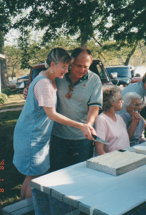 McLouth, April 2001--cutting the cake (after two of the sisters-in-law had already helped themselves to a piece not realizing that we were intended to cut it first!)