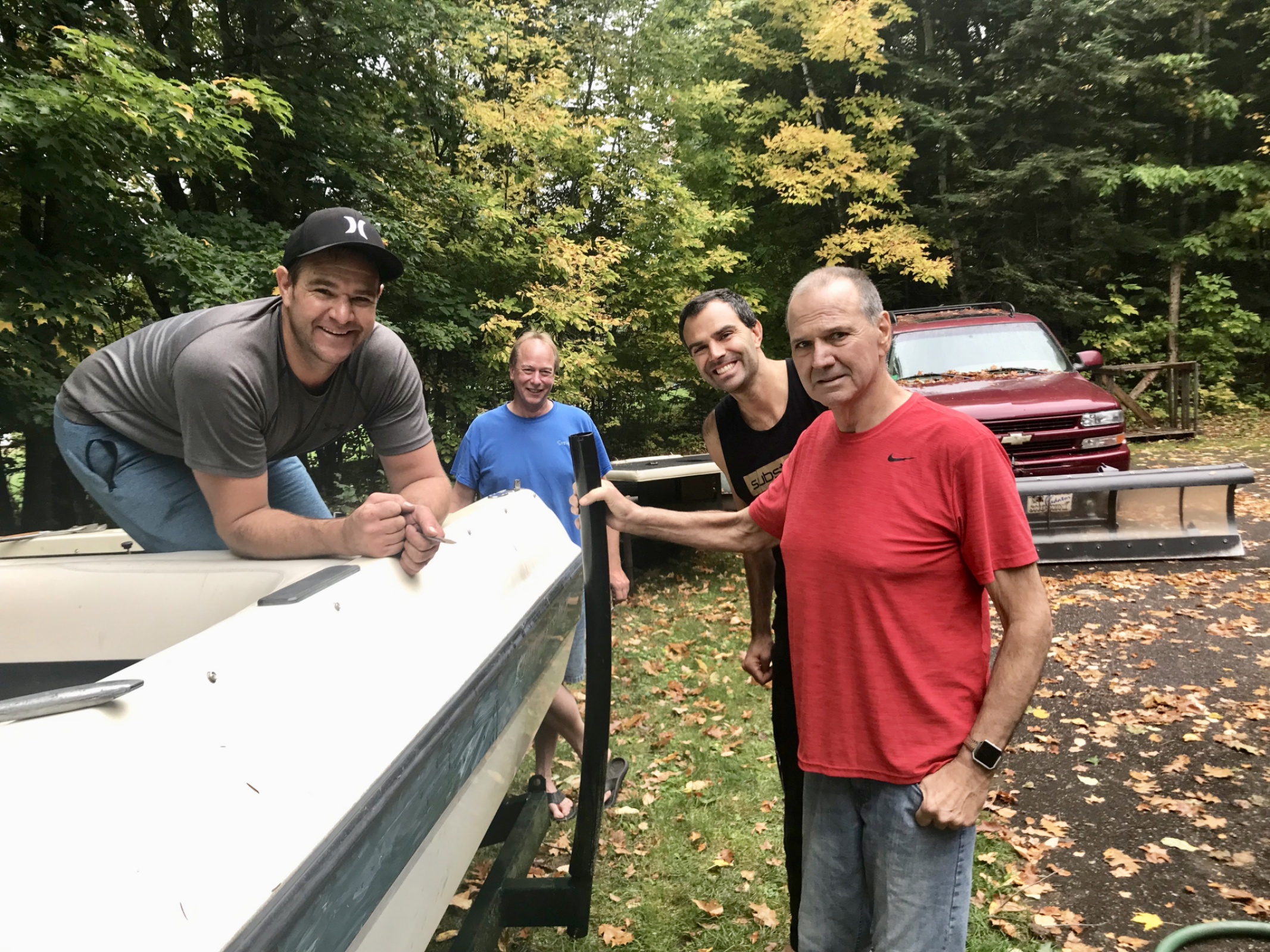 "Manager Steve helps Jeff & Jon winterize our, boat but Chuck is still the ""guy in charge!"""