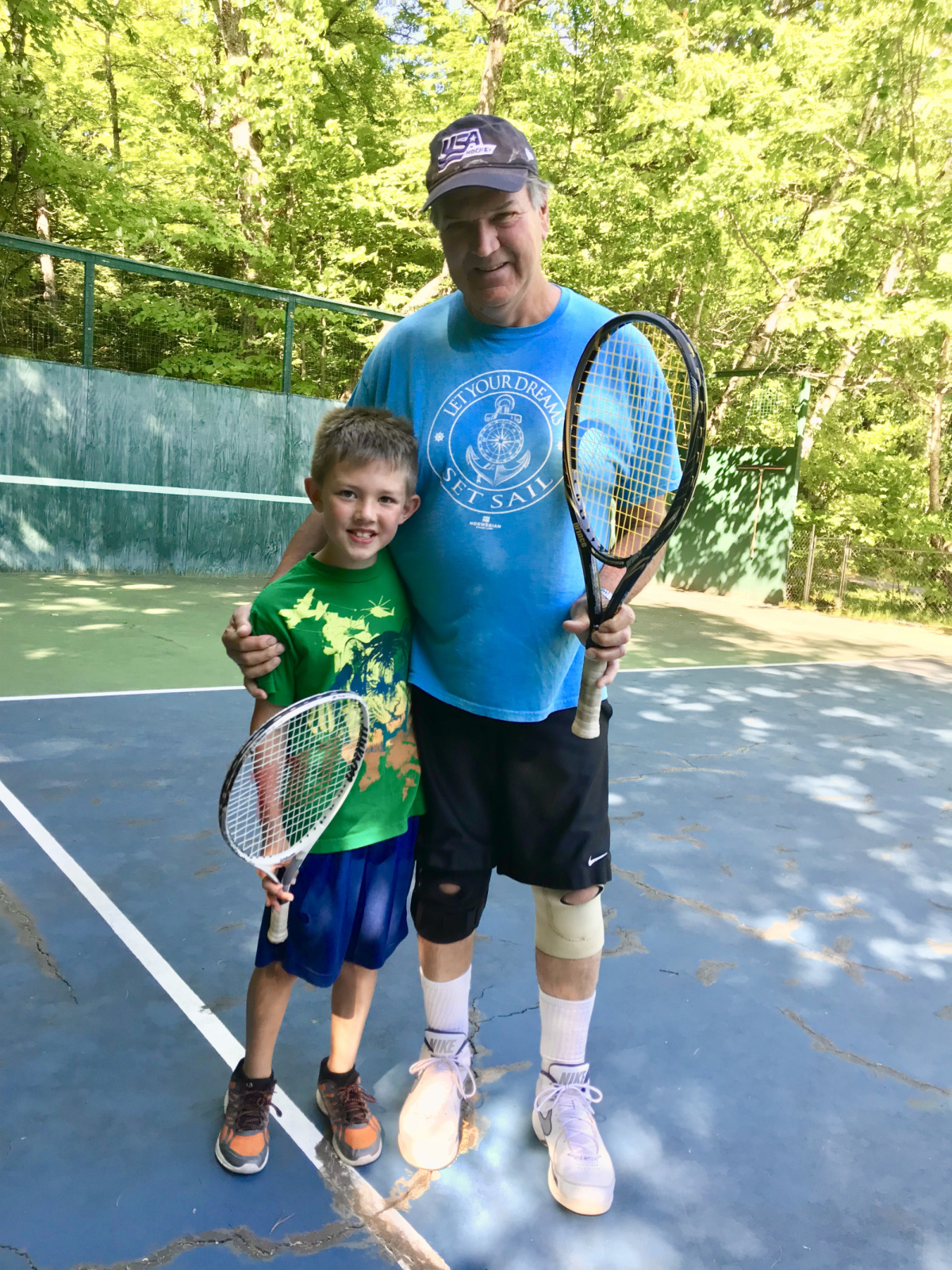 Teaching oldest grandson, Jonah,  tennis & competition~!!