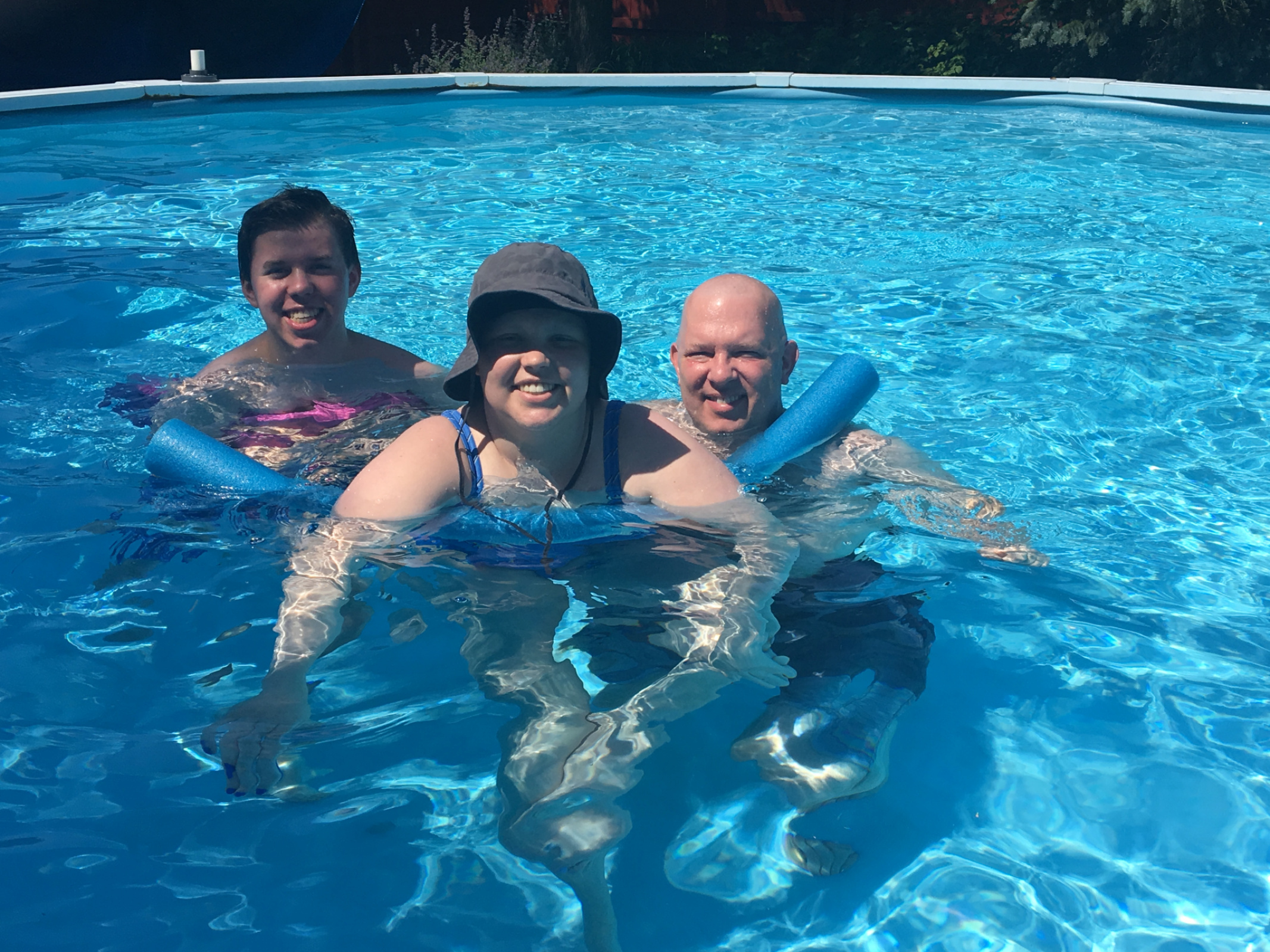 I somehow managed to get in the pool with dad, mom and Quinn's help. It was so relaxing and fun to be outside.