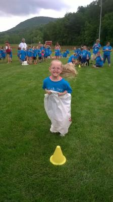 Ava enjoying the sack race during field day!  Her class understandably finished last but won the best sportsmanship award for the day and most importantly, had fun!!