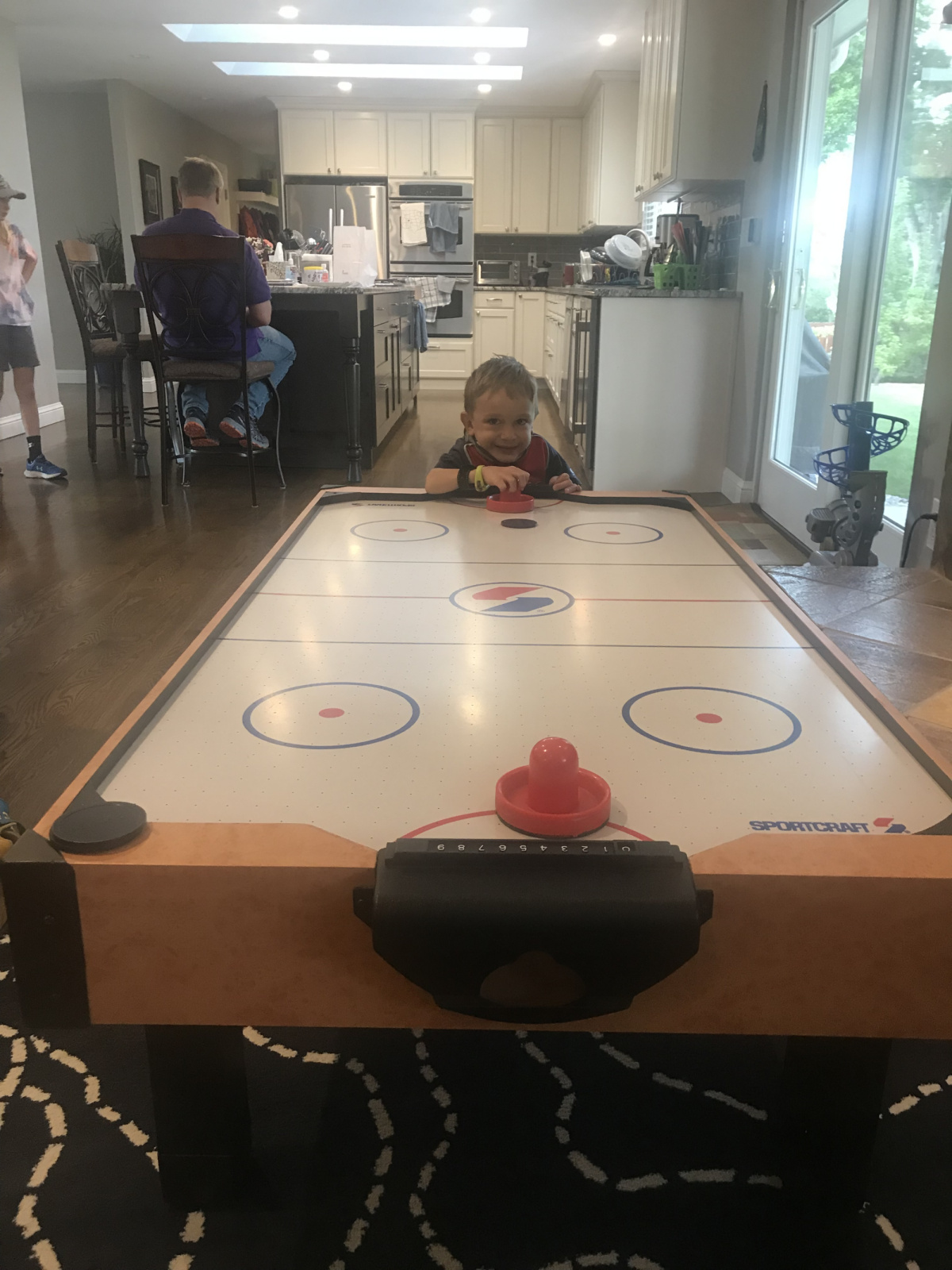 Air hockey. All. The. Time. Thank you to our friend who not only handed down the table to us, but also chopped the legs down to exactly the height Cooper needs.