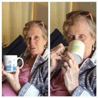"Mum enjoying hot chocolate from her life saver Jeannie, in the ""God's Gift"" mug... with a photo of Kevin's ugly mug on it!!!"