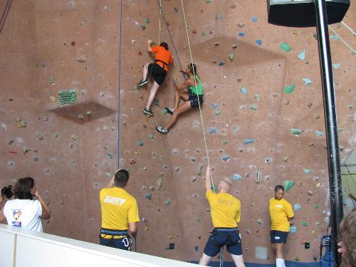 8/2010 Mandy climbing rock wall at Great Lakes Naval Base during RIC Military Paralympics sports camp