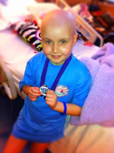 Maya proudly showing off her Team in Training medal that Vince Hopkins gave her from his 100 mile Tahoe ride!