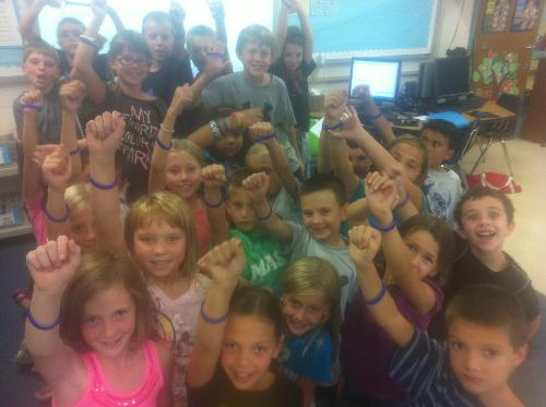 Maya's class show off their wristbands in support!