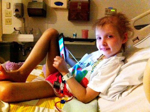 Maya playing on the iPad while she gets her new marrow!