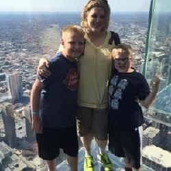 "Me and the boys in the ""Sears"" tower in Chicago.  I did not like looking down!"