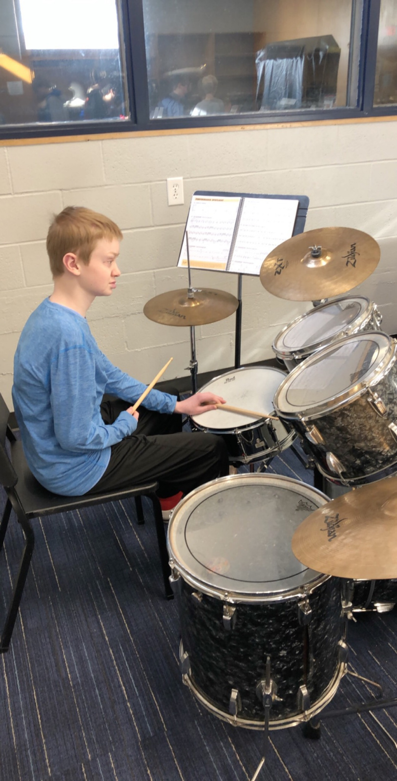 Caleb playing the trap set during jazz band.
