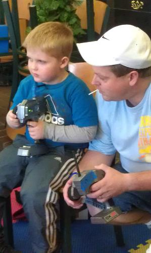 Driving big R/C cars at Ronald McDonald House. A group drove 10 hrs to bring them down to play with.