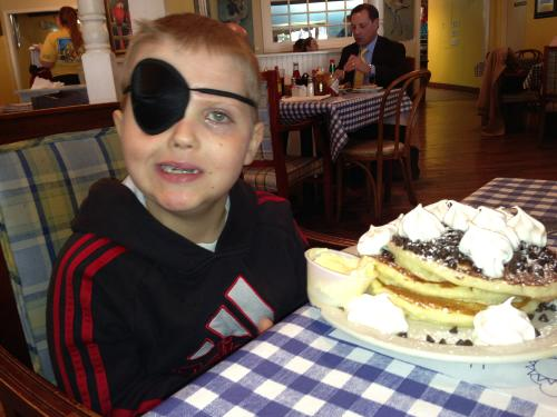 Carson and his chocolate chip pancakes at Blue Plate Cafe. He ate 3/4ths all by himself!!